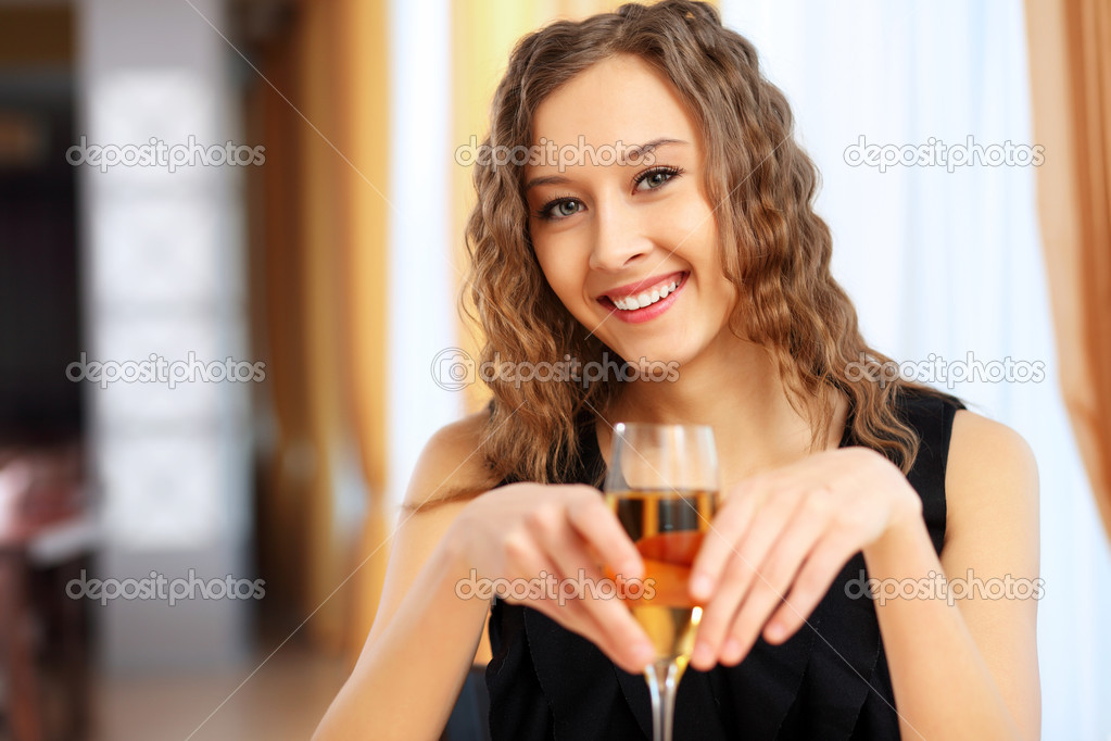 Portrait of a young pretty woman sitting in restaurant  Stock Photo #10124229