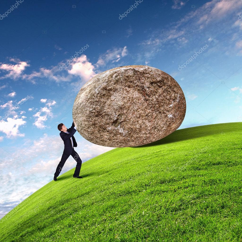 Image of businessman rolling a giant stone — Stock Photo #10127529
