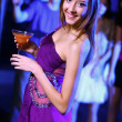 Young woman having fun at nightclub disco — Stock Photo #10259721
