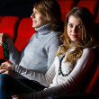 Young couple in cinema watching movie — Stock Photo #10259736