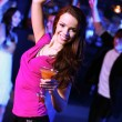 Young woman having fun at nightclub disco — Stock Photo
