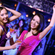 Young woman having fun at nightclub disco - Stock Photo