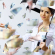 Business woman under money rain with umbrella — Stock Photo #10259875