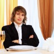 Young handsome man sitting in restaurant — Stock Photo #10259893