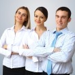 Three successful young business persons together — Stock Photo #10260031