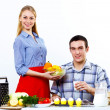 Husband and wife together coooking at home - Foto de Stock