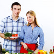 Husband and wife together coooking at home — Stock Photo #10260069