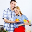 Husband and wife together coooking at home — Stock Photo #10260097