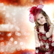 Foto Stock: Little girl dressed up in beautiful dress