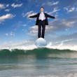 Businessman surfing on the sea waves — Stock Photo #10260422