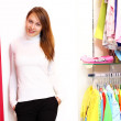 Young woman inside a store buying clothes — Stock Photo #10260543
