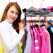 Young woman inside a store buying clothes — Stock Photo #10260551
