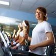 Young man doing sport in gym — Stock Photo #10260605
