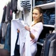 Shopping in clothes store — Stock Photo #10261002
