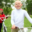 Boy on a bicycle in the green park — Stock Photo #10261303