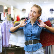 Woman in a shop buying clothes — Stock Photo #10261318