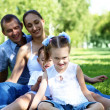 Family with two children in the summer park — Stock Photo #10261347