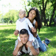 Family together in the summer park — Stock Photo #10261393