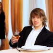 Young handsome msitting in restaurant — Stock Photo #10268209