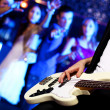 Young guitar player performing in night club — Stock Photo #10268293