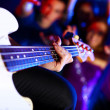 Young guitar player performing in night club — Stock Photo #10268380