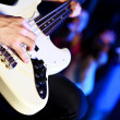 Young guitar player performing in night club — Stock Photo #10268446
