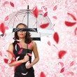 Pretty woman under umbrella with petals around her — Stock Photo #10268805
