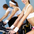 Young woman doing sport in gym — Stock Photo #10269612