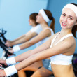 Young woman doing sport in gym — Stock Photo #10269622