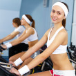 Young woman doing sport in gym — Stock Photo #10269657