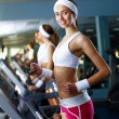 Young woman doing sport in gym — Stock Photo #10269668