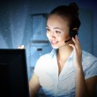 Young woman in business wear and headset — Stock Photo