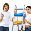 Young couple with paint brushes together - Foto de Stock