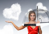 Ganska ung kvinna med paraply och hjärtan — Stockfoto