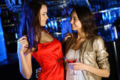 Attractive woman in night club with a drink — Foto de Stock