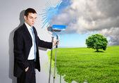 Junger Geschäftsmann und Natur Hintergrund — Stockfoto