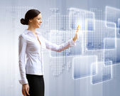 Business woman and touchscreen technology — Stock Photo
