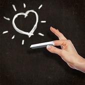 School blackboard and heart symbol — Stock Photo