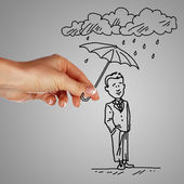 Man under rain holding umbrella — Stock Photo