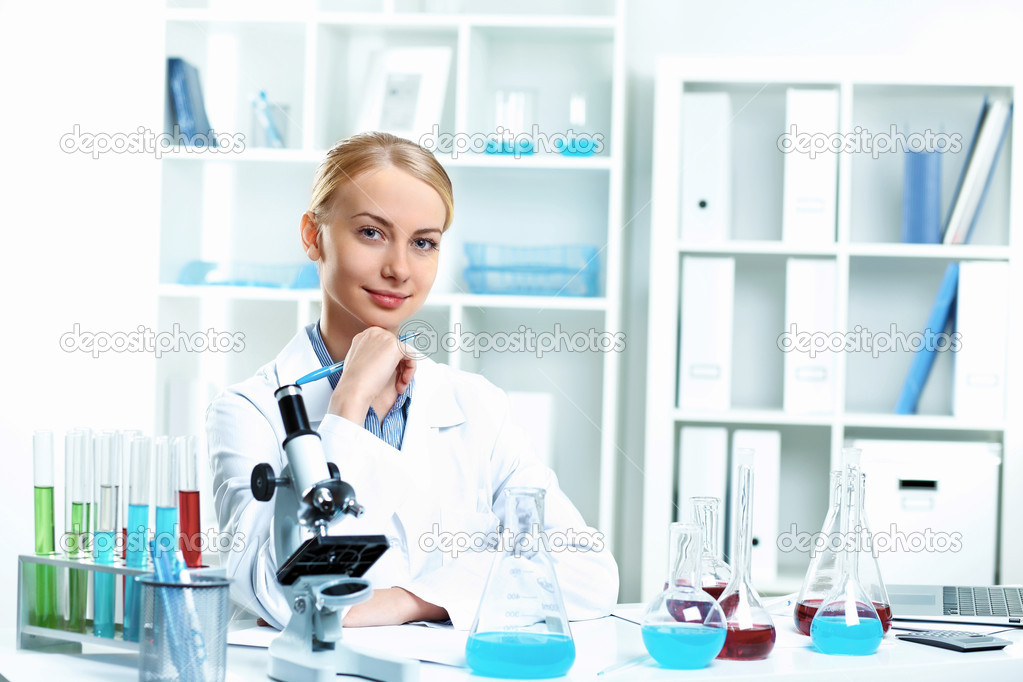 Young scientist in white uniform working in laboratory — Stock Photo #10260648
