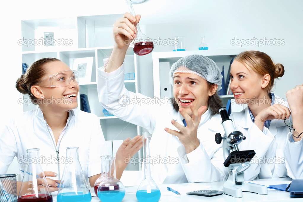 Young scientists in white uniform working in laboratory — Stock Photo #10260653