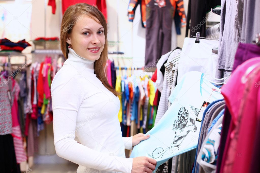 Portrait of young woman inside a store buying clothes  Stock Photo #10269482