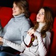 Young couple in cinema watching movie — Stock Photo #10270013