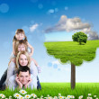 Collage with children and parents on green grass — Stock Photo #10271534