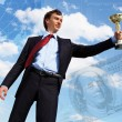 Young businessnman with award — Stock Photo #10271757