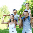 Family with two children in the summer park — Stock Photo #10273141