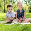 Children in the park reading a book — Stock Photo #10273242