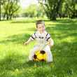 Little boy in the park playing with a ball — Stock Photo