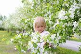 Little girl in spring park — Stock Photo