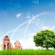 Collage with children and parents on green grass — Stock Photo #7973335